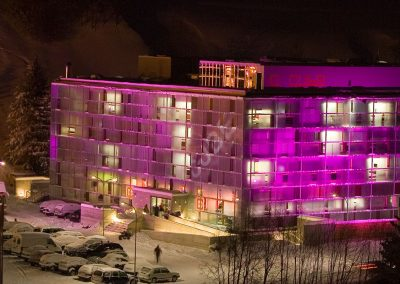 cube hotel exterior view winter pink night